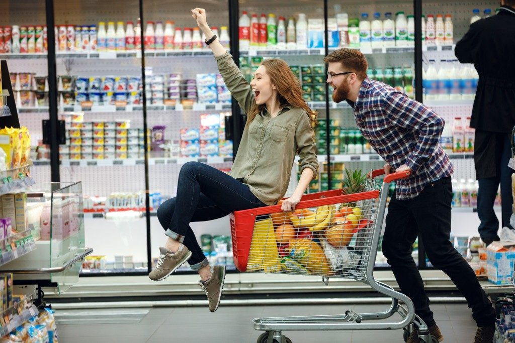 couple playing around at grocery store