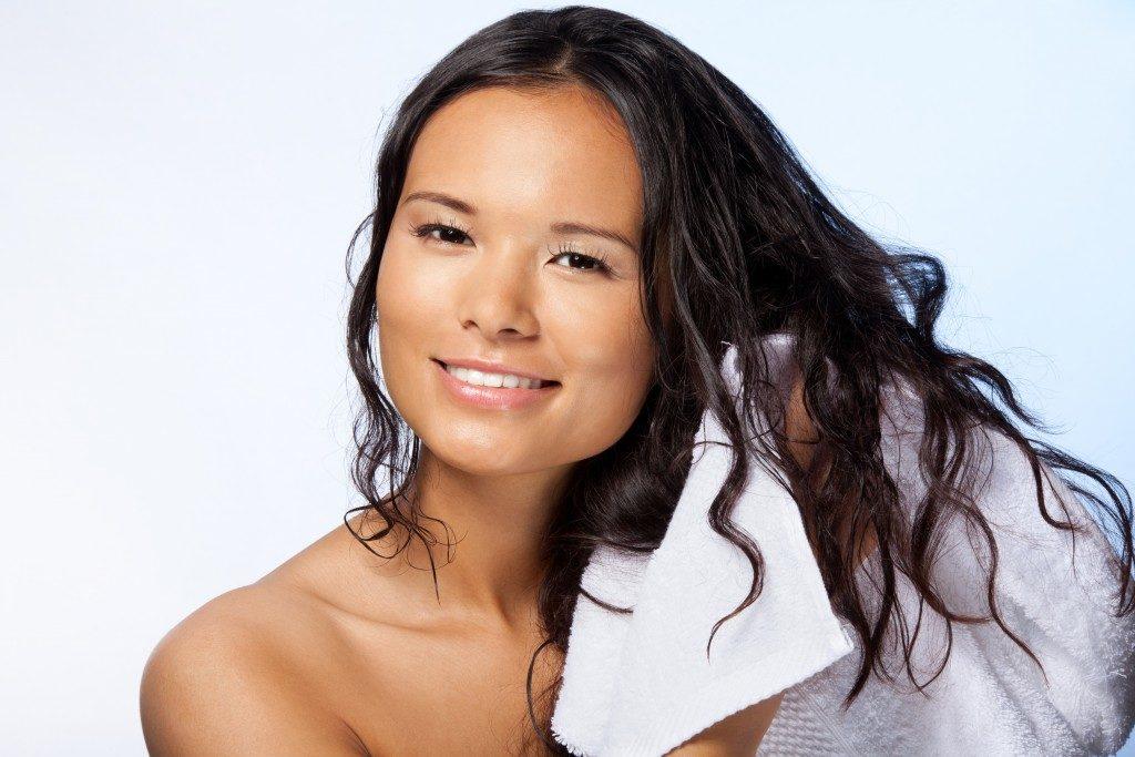 Woman wiping hair
