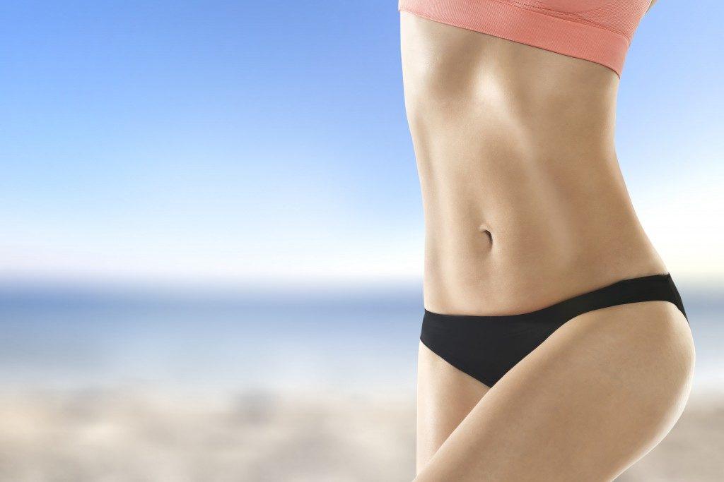 girl wearing bikini in the beach