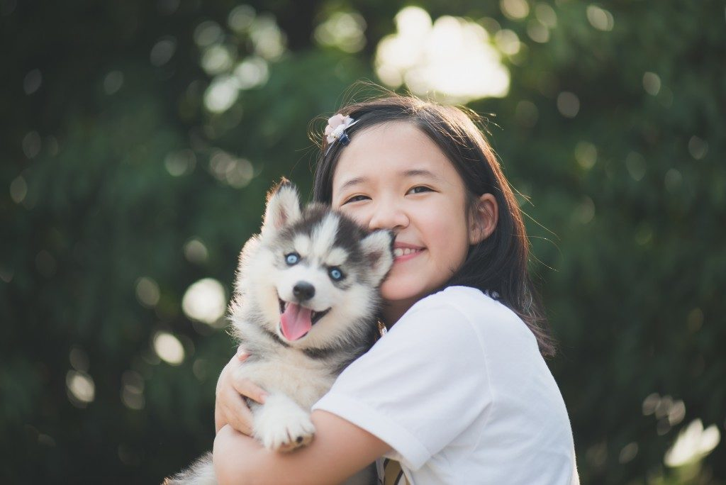 girl with husky puppy