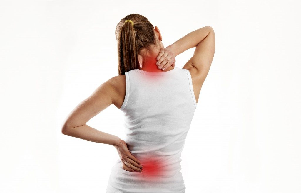 woman with neck and lower back pain