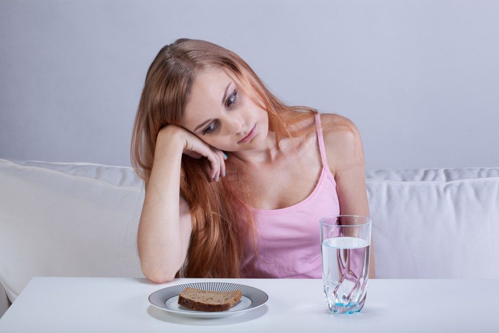 Portrait of young girl with eating disorder