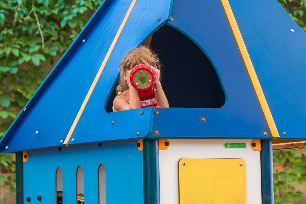 girl in the children's house playground
