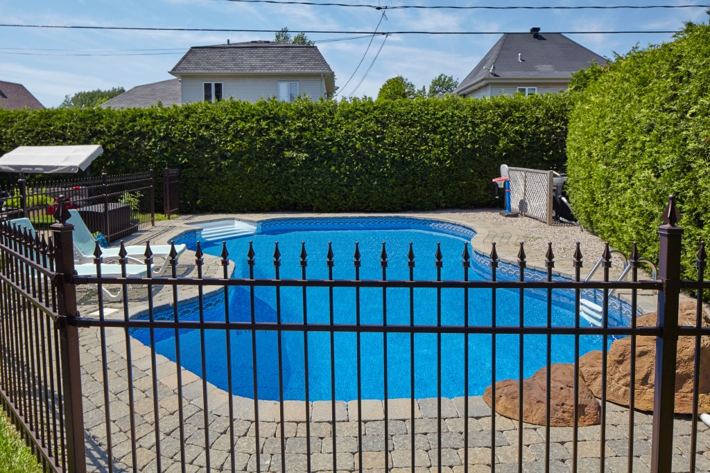 Swimming pool behind fence