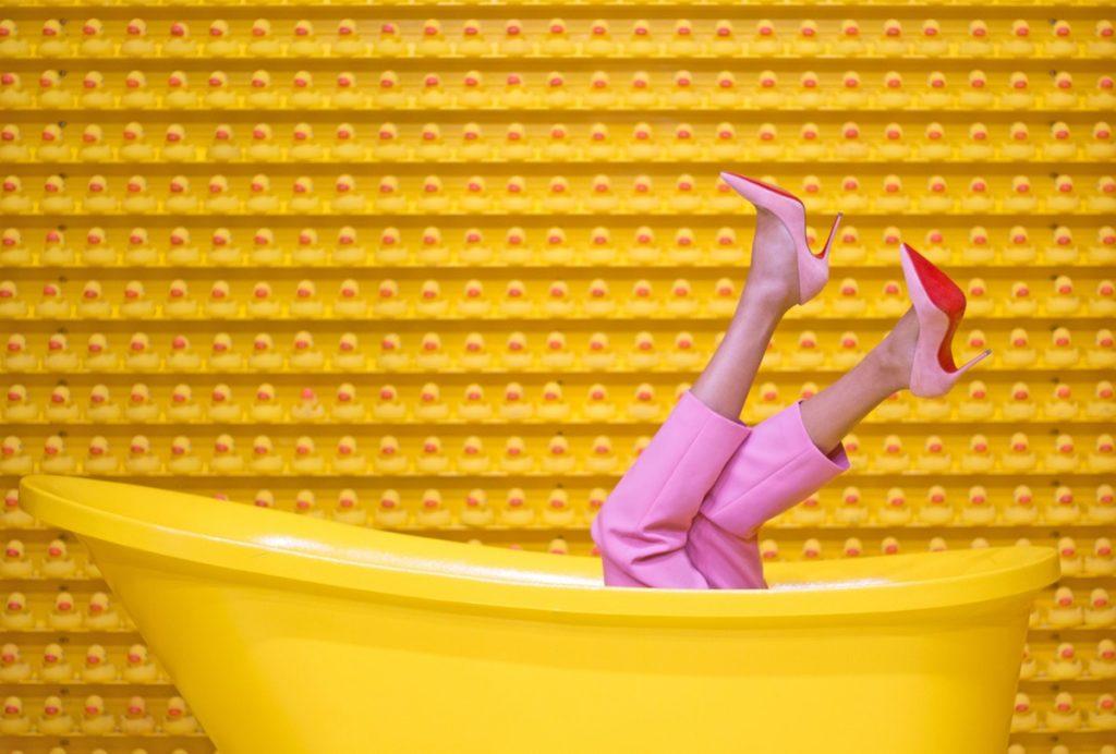 woman wearing shoes in a bathtub