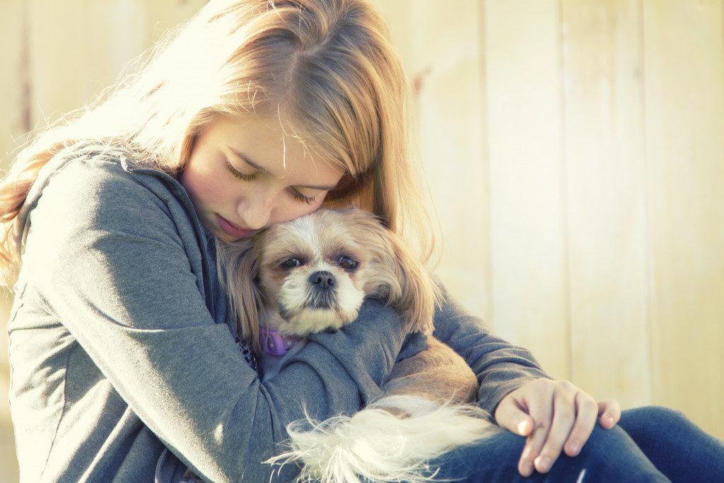 sad child with dog