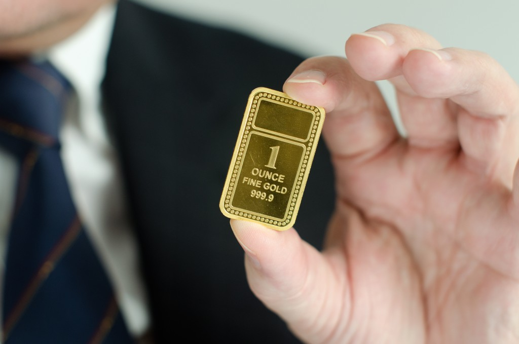 Gold bar being held