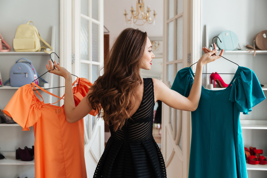 woman choosing what dress to wear